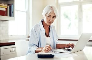 single senior woman working on finances