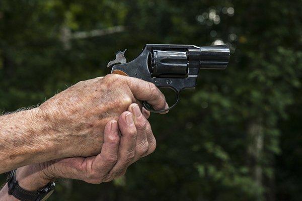 Senior aiming revolver pistol