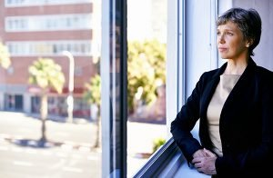 Shot of a thoughtful businesswoman looking out of an office window