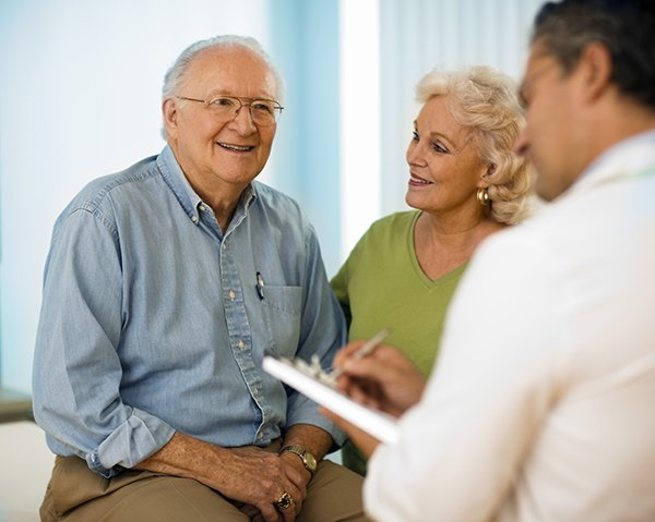 Senior couple visiting with doctor