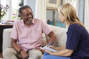 older man smiling at caregiver