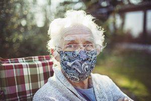 senior wearing a mask