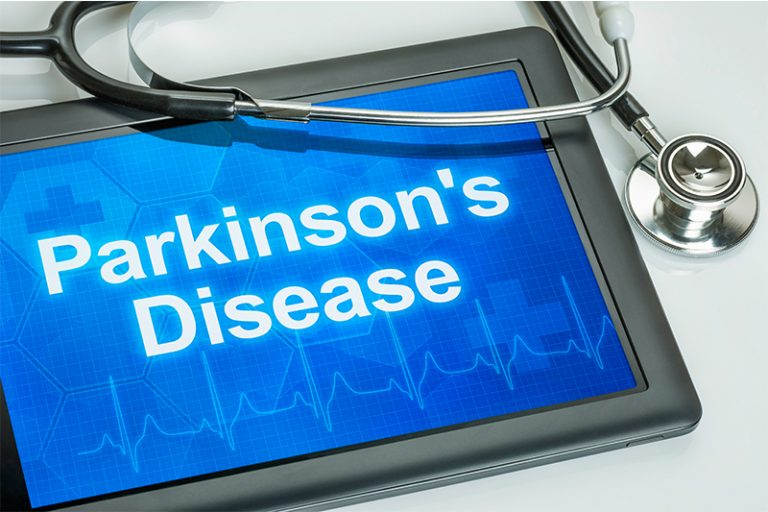 Doctor's ipad with Parkinson's Disease displayed on the screen