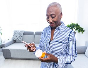 Woman Checking Information on Her Medicine