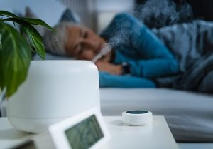 senior woman sleeping with a humidifier