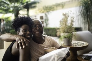 family caregiver smiling with senior loved one