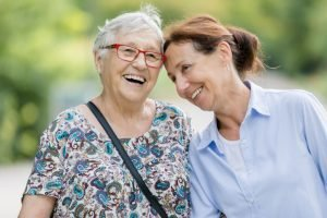 senior taking a walk with family caregiver