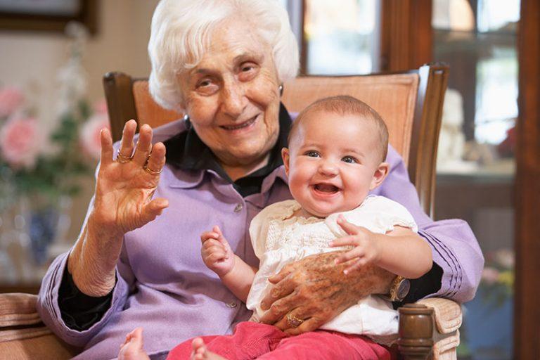 Senior woman holding her grandchild
