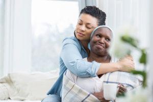 adult daughter embracing senior mother