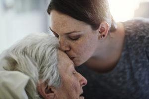 Shot of a daughter visiting her senior mother in hospital