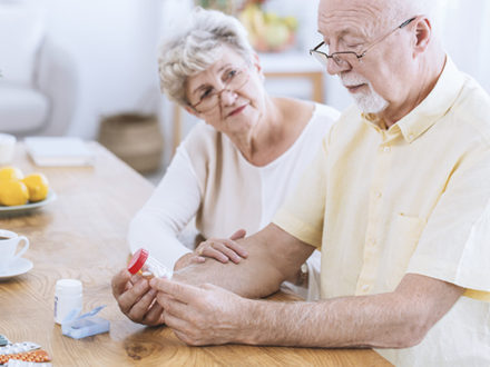 senior husband and wife reviewing medications