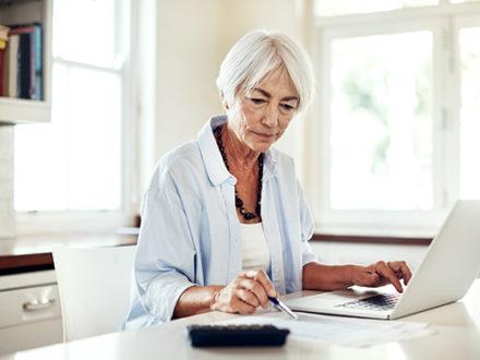 single senior woman working on finances